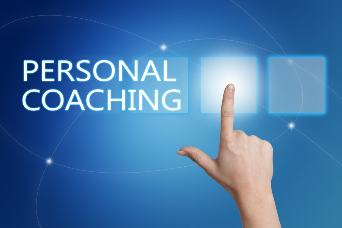 Personal Coaching - hand pressing button on interface with blue background.